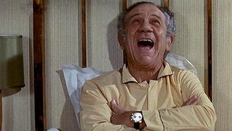 Sid James wearing a Breitling Top Time